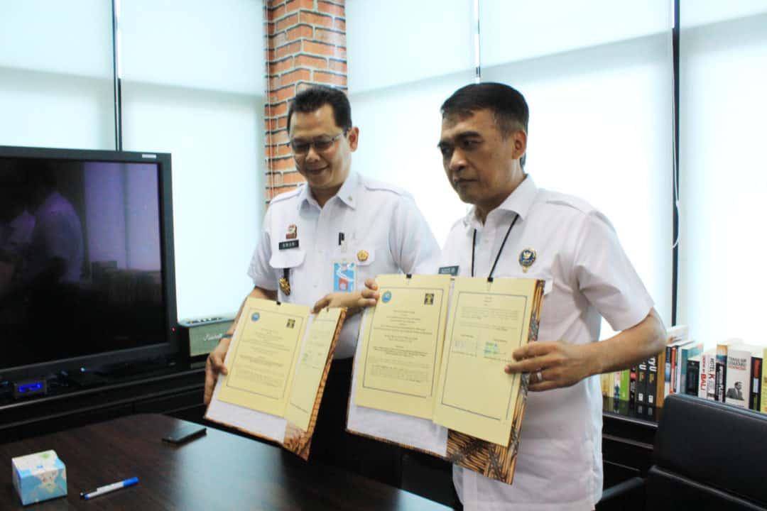Penandatanganan Perjanjian Kerja Sama antara Pusat Penelitian Data dan Informasi BNN dengan Pusat Pengkajian dan Pengembangan Kebijakan Kemenkumham RI